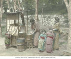 Family group at outdoor food stand, Japan, ca. 1921