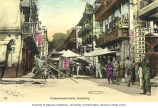 Stalls and businesses in crowded street, Hong Kong, n.d.