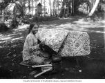 Woman creating batik cloth, Java, ca. 1921