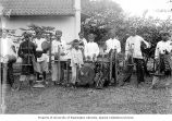 Group of musicians with traditional Javanese instruments, including angklung bamboo rattles and...