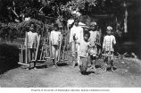 Group of boys with bamboo instruments called angklung, Java, ca. 1921