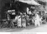 Street scene showing outdoor vendors, Semarang, ca. 1921