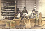 Women reeling raw silk from the cocoons of silkworms, Kobe, Japan, ca. 1906