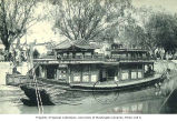 Ornate boat on river with crowd watching from riverbank, Peking, China, ca. 1907