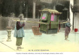 Sedan chair with porters, China, ca. 1905