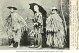 Laborers in straw raincoats and umbrella with bundle of provisions, China, ca. 1910
