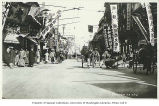 Foochow Road showing businesses rickshaws, and pedestrians, Shanghai, China, ca. 1925