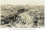 Avenue Edward VII with automobiles, pedestrians, soldiers in formation and view of city, Shanghai,...