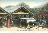 Peak Tramway terminus station with cable car and passengers, Hong Kong, n.d.