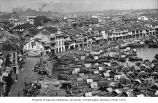Boat Quay showing waterfront businesses and sampans, Singapore, n.d.