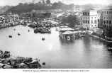 Waterfront scene with sampans, Singapore, n.d.