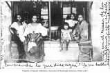 Store front with women and children, Manila, ca. 1906