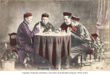 Chinese men dining at a table, Hong Kong, n.d.