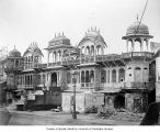 Islamic building with people and street light, India, n.d.
