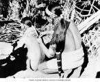 Daughters of Wancho Ang chief dressing their hair with split bamboo bands, cloth and metalic...