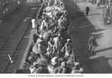 Chinese troops and supplies riding on railroad cars, ca. 1931