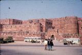 Visitors looking at Red Fort outer walls, Agra, Uttar Pradesh, India, ca. 16th century A.D.