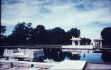Distant view of marble pavilion and reflecting pool at Shalimar Gardens in Lahore, Pakistan, ca....
