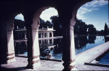 Reflecting pool and marble pavilion, viewed through archways, at Shalimar Gardens, Lahore, Punjab,...