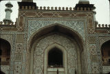 Close up of cutouts and painted decoration on main gateway to Tomb of Akbar the Great in Sikandra,...