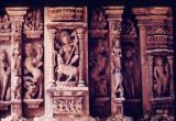 Close up of sculpted figures in niches on Ambika Mata temple wall, Jagat, Rajasthan, India, ca....