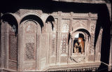 Close up of window screens with a man leaning out of window, Mehrangarh Fort palace, Jodhpur,...