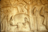 Milking cow detail from temple verandah Govardhana relief, Mahabalipuram, Tamil Nadu, India,...