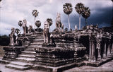 Steps rising to a platform, flanked by guardian lions, Angkor Wat temple complex, viewed from...
