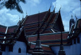 View looking upward at temple roofs in Wat Bemchamabophit, Bangkok, Thailand, ca. 19th-20th...