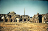 Distant view of Firoz Shah Kotla ruins, with Maurya Emperor Ashoka's pillar in background, Delhi,...