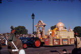 Tractor pulling float with stupa, torana, and monks in colored robes, Republic Day Parade, New...