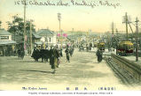 Street scene showing streetcars and pedestrians on Kudan Hill, Tokyo, Japan, ca. 1910.