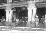 Men and women seated on steps of building, Chamba, ca. 1899