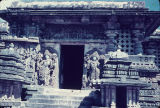 Temple doorway flanked by tall sculptures of standing male figures, Hoysaleswara Temple complex,...