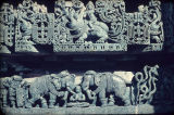 Two friezes, lower frieze depicting elephants flanking seated male and uppper frieze depicting a...
