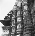 Devangana Mithuna sculptures on the exterior of the Kandariya Mahadeva Temple, in Khajuraho,...