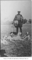 Doc Hamilton with pheasants and hunting dogs, ca. 1926