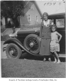 Irene Alexander and her daughter Jacqueline with car, Seattle, ca. 1934