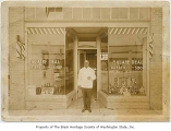 William Jackson in front of Square Deal Barber Shop, Seattle, ca. 1930