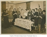 Women and uniformed men toasting, Seattle, ca. 1945