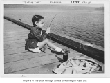 Gwen Lawson fishing from dock on Lake Washington, Seattle, 1955