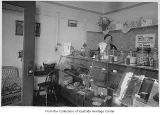 Addie Hurley behind counter in Charley Younger's Candy Shop, Kirkland, ca. 1942
