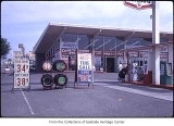 Texaco station and Firestone Tires, Bellevue, ca. 1969