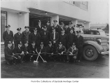 Firemen with truck at fire station, Bellevue, June 1947