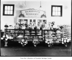 Employees behind display cases at Schmidt's Bakery, Kirkland, 1940