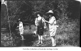 Glenette, Phyllis, and Gretchen Hill fishing at Juanita Creek, Juanita, ca. 1925