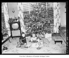 Children with Christmas tree, Redmond, December 26, 1955