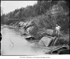 Car bodies on bank of Snoqualmie River to prevent erosion, Duvall, 1955