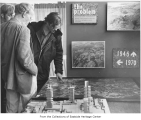 Fred Herman and two other men looking at map, Bellevue, ca. 1970