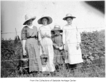 Group with buckets of berries, possibly in Redmond, ca. 1910